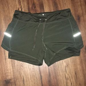 Green athletic shorts